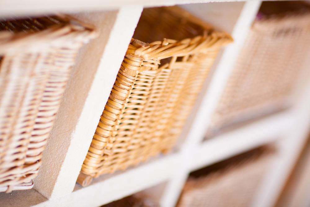 Wicker baskets in cube shelves in a closet