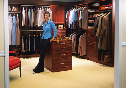 Fully staged Mahogany walk-in closet design by Boston Closet