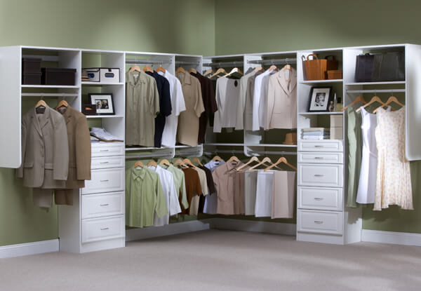 Deluxe walk-in closet in brown finishes and white panel drawers