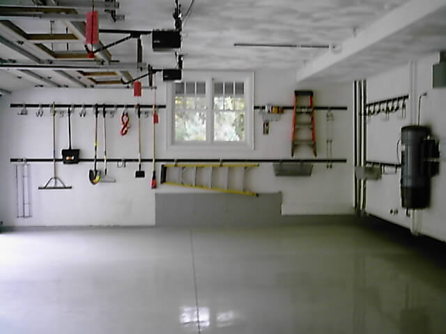 Home improvement tool racks and hooks for garage walls