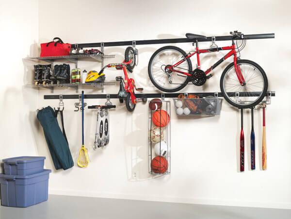 Heavy-duty garage wall racks with hooks and baskets for sports supplies