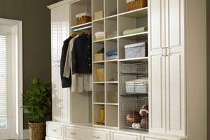 White mudroom cabinet system with open shelves and raised panels