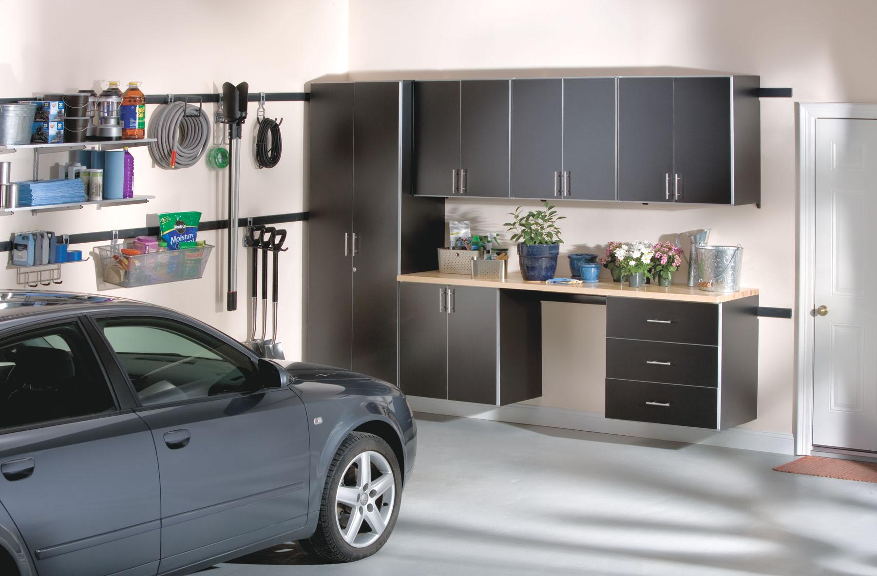 Garage cabinets over a workbench in a Boston garage