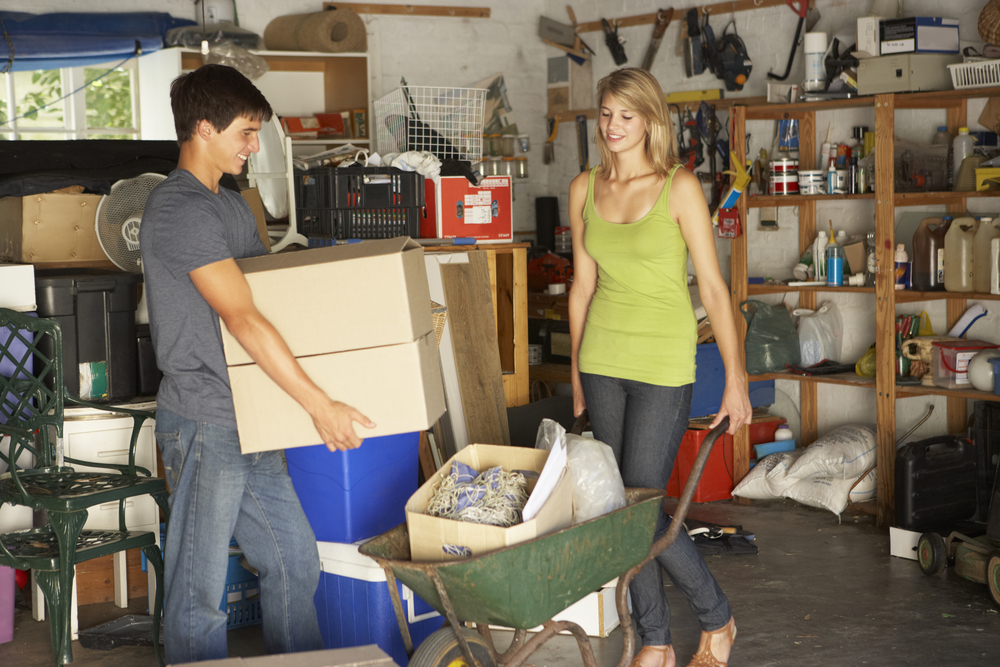 Couple cleaning garage together
