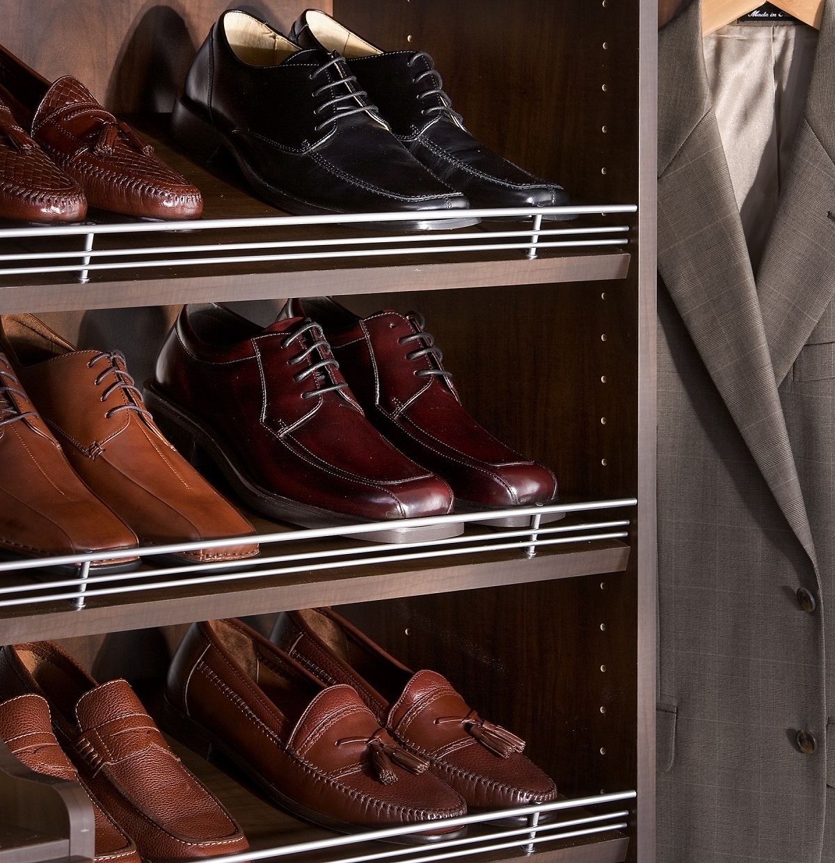 Men's dress shoes on angled shoe shelf in Boston, MA