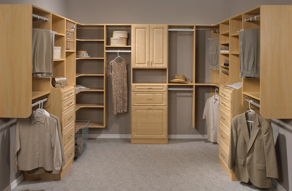 Maple walk-in closet example in Cape Cod with raised panel cabinets