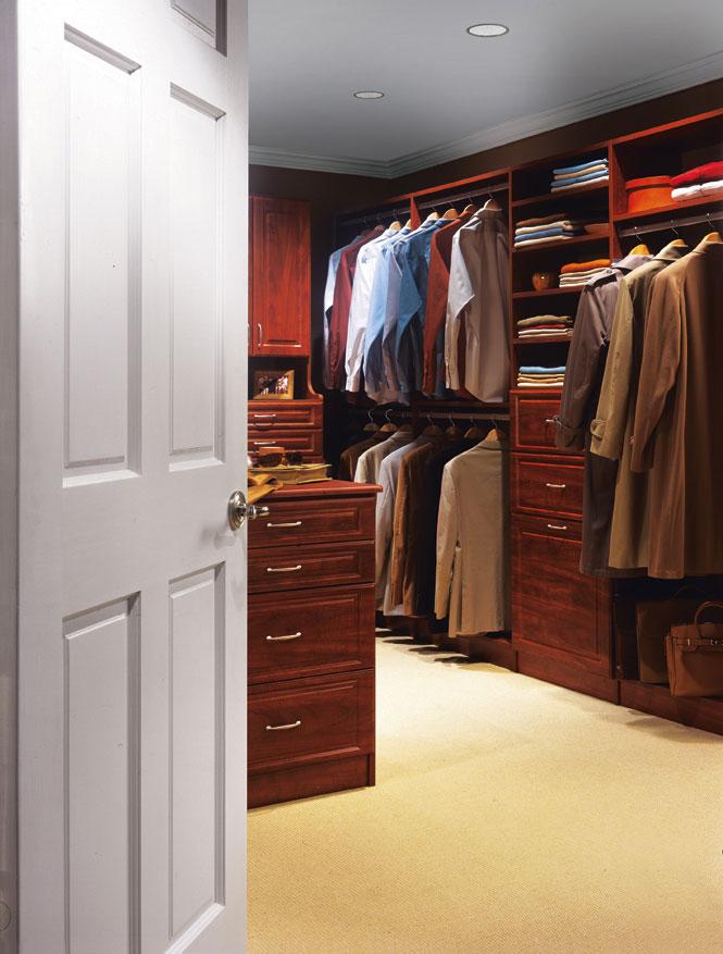 Custom walk-in closet design in Barnstable in dark cedar finish