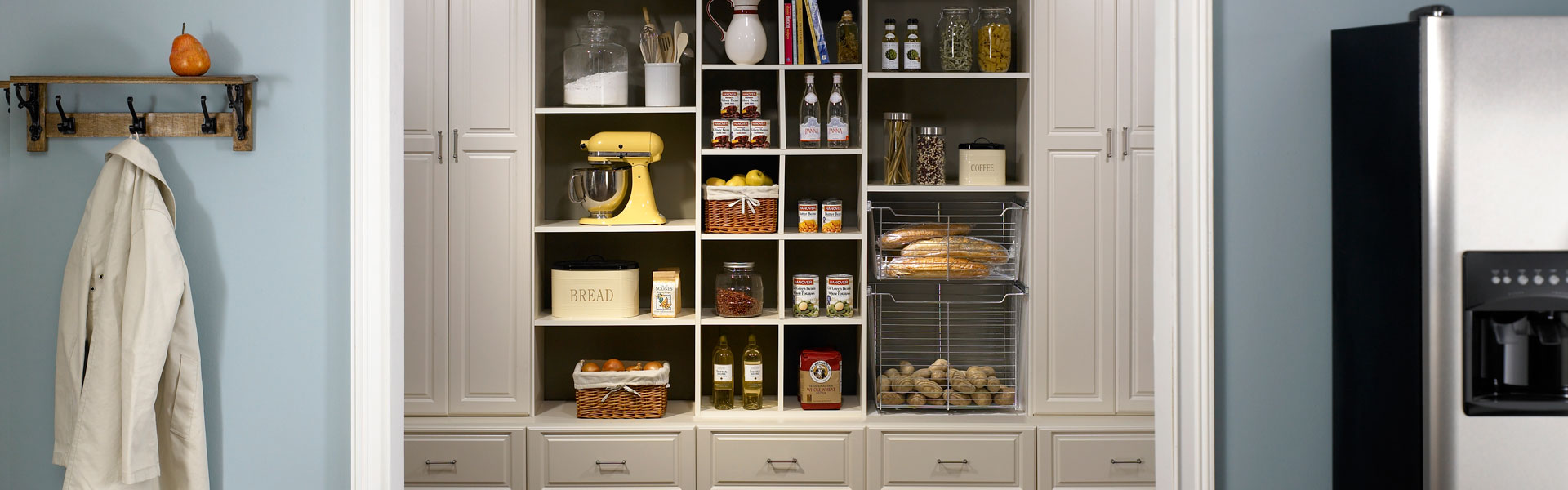 Functional walk-in pantry design in Ivory for Plymouth home