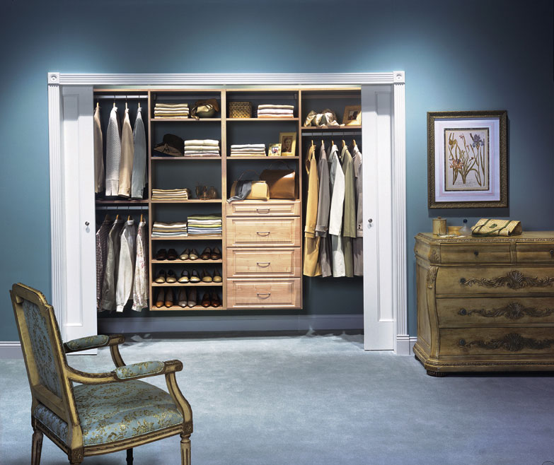 Wood laminate reach-in closet design in Light Pine for Saugus homeowner