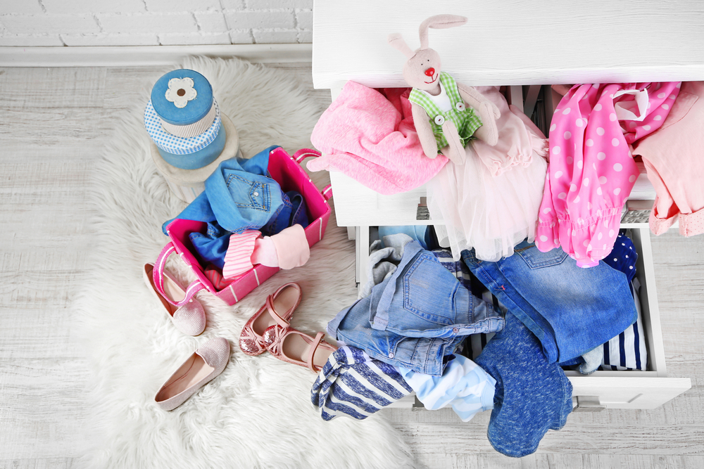 Close up of messy children's clothes and toys