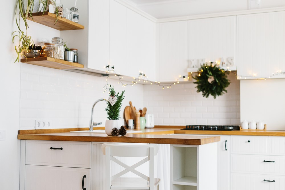 A white kitchen decorated for the holidays.